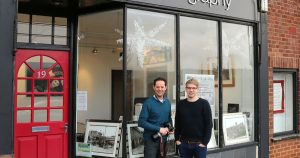 matt and joe ollier in front of ollier photography studio