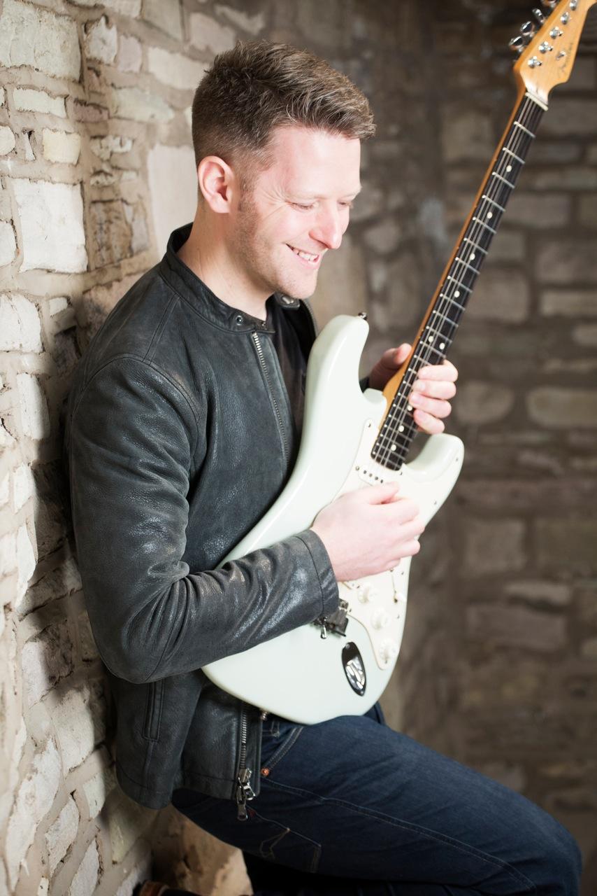 ollier photography joseph alexander with guitar